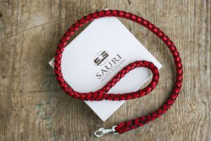 Red stitched plaited leather dog leash by Workshop Sauri