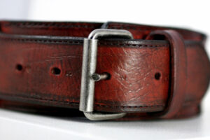 Antique red leather dog collar-buckle detail