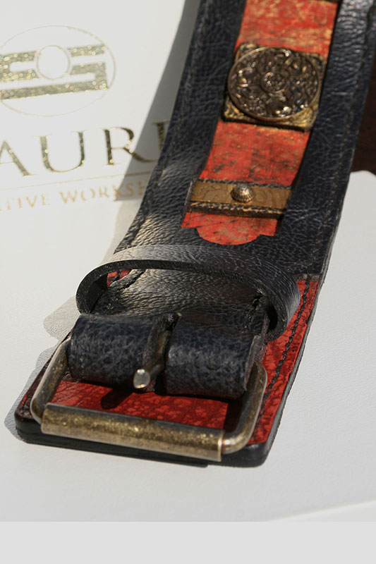 Black and red leather collar with rich brass ornamentation